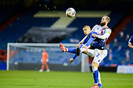 Kevin van Veen (10) of Scunthorpe United Harry Clarke (2) of Oldham Althletic battles for possession during the EFL Sky Bet League 2 match between Oldham Athletic and Scunthorpe United at Boundary Park, Oldham, England on 14 November 2020.