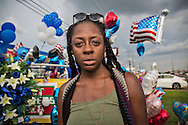"""Breelyn Jackson at a<br /> makeshift memorial for the police officers on Airline Highway in Baton Rouge at the  B-Quik gas station.  She is deeply troubled by the killings of Alton Sterling and the police. """"Everyone is falling down like flies,"""" she said, """" It is a message from the lord that we must do something. When young people stand up for a cause, people should listen."""""""