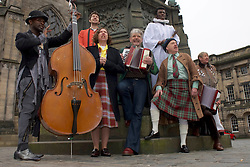 Actors perform a few songs from I am Thomas in costume in Parliament Square, Edinburgh, 23rd March 2016,Actors left to right: John Pfumojena, Dominic Marsh, Amanda Hadingue, Iain Johstone, Charlie Folorunsho, John Cobb, Hannah McPake, Myra McFadyen<br /> (c) Brian Anderson   Edinburgh Elite media