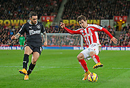 Two-goal Danny Ings of Burnley competes with Bojan of Stoke (right) - Football - Barclays Premier League - Stoke City vs Burnley - Britannia Stadium Stoke - Season 2014/2015 - 22nd November 2015 - Photo Malcolm Couzens /Sportimage