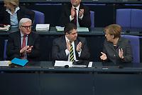 13 FEB 2014, BERLIN/GERMANY:<br /> Frank-Walter Steinmeier (L), SPD, Bundesaussenminister, Sigmar Gabriel (M), SPD, Bundeswirtschaftsminister, und Angela Merkel (R), CDU, Bundeskanzlerin, applaudieren zu Beginn der Bundestagsdebatte zum Jahreswirtschaftsbericht, Plenum, Deutscher Bundestag<br /> IMAGE: 20140213-01-012<br /> KEYWORDS; Applaus, klatschen