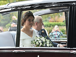 Princess Eugenie rides in a car with her husband, the Duke of York on her way to marry Jack Brooksbank at St George's Chapel in Windsor Castle.