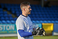 AFC Wimbledon goalkeeper Joe Day (21) warming up prior to kick off during the EFL Sky Bet League 1 match between AFC Wimbledon and Fleetwood Town at the Cherry Red Records Stadium, Kingston, England on 8 February 2020.