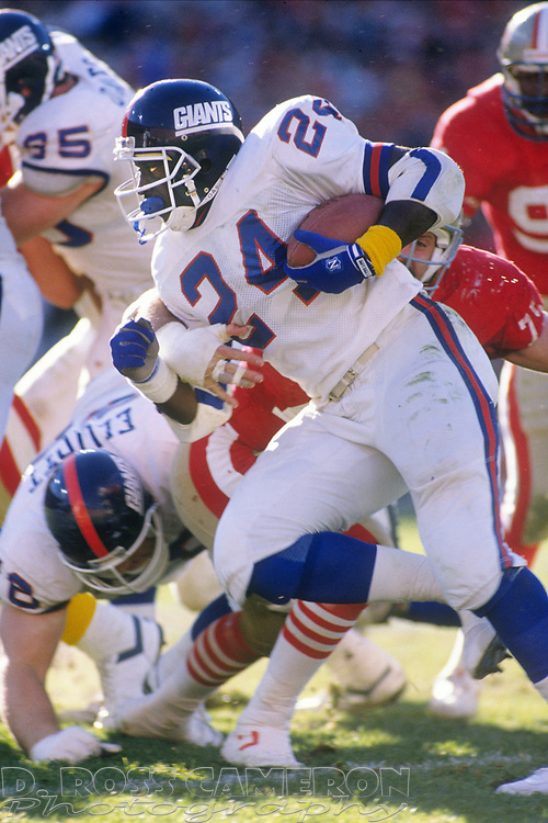 New York Giants running back Ottis Anderson carries the ball against the San Francisco 49ers during the first quarter of an NFC championship football game, Sunday, Jan. 20, 1991 at Candlestick Park in San Francisco. Anderson was held to just 67 yards on 20 carries and no touchdowns, but the Giants won, 15-13 and now move on to the Super Bowl against the Buffalo Bills. (Photo by D. Ross Cameron)