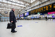 UNITED KINGDOM, London: 18 March 2020 <br /> A desolate London Waterloo train station during rush hour at 09.25 this morning. Train stations across the capital have seen the number of commuters dramatically drop as people are urged to work from home in order to try and keep the spread of the Covid-19 virus under control.