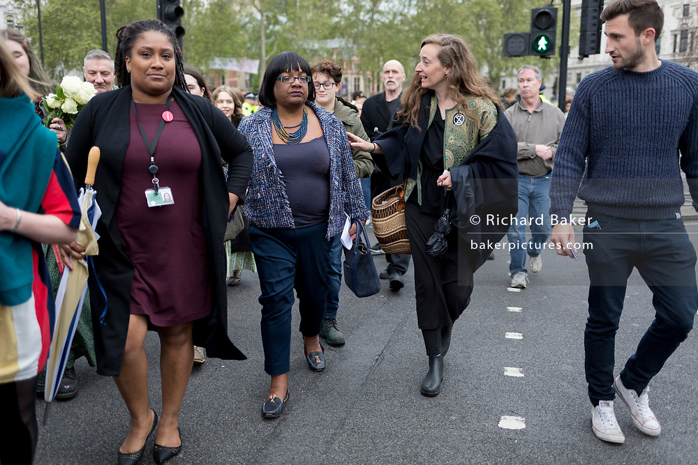On the 10th consecutive day of protests around London by the climate change campaign Extinction Rebellion, Labour MP Diane Abbot walks back into Parliament after addressing protesters in Parliamant Square, on 24th April 2019, in Westminster, London England.