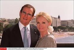 © Sophie Boulet/ABACA. 24839-4. Cannes-France, 3/4/2001. Roger Moore and partner Christina Tholstrup pose for photographers at the MIP TV (International Market for tv programs)