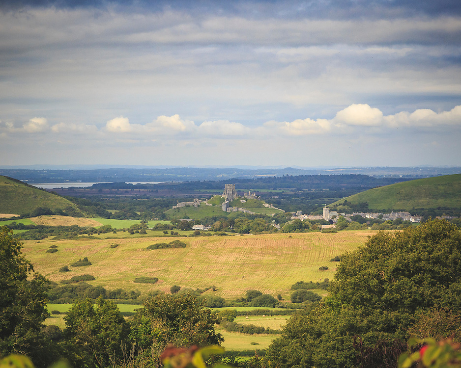 Corfe Castle in the gap of the Purbeck Hills. Iconic relic of the English Civil war. Taken from the welcome benches of The Scott Arms in Kingston.