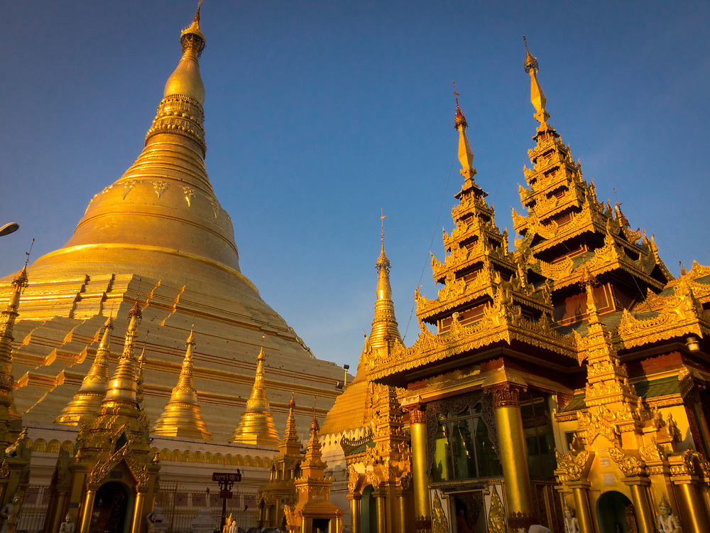 Statues and spires in the Shwedagon Pagoda complex. situated on Singuttara Hill in the center of Yangon (Rangoon), It is the most sacred Buddhist stupa in Myanmar and one of the most important religious reliquary monuments in the world