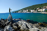 Statue of Lady with Seagull, town of Opatija in distance. Opatija, Croatia