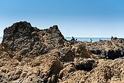 people recreating on the beach rocks at Tateishi Park Kanagawa Japan