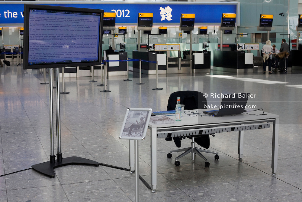 Empty desk belonging to a working Heathrow writer-in-residence, Alain de Botton while writing his airport novel in Terminal 5.