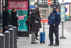 © Licensed to London News Pictures. 05/11/2020. London, UK. Commuters arrive at London Victoria Station on the first day of the new lockdown as police enforce wearing of masks while travelling on public transport. Prime Minister Boris Johnson announced last Saturday a new Covid-19 lockdown restrictions for England from Thursday (today) with pubs, restaurants, non-essential shops and gyms to close as the coronavirus infection rate continues. Photo credit: Alex Lentati/LNP