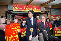 © Licensed to London News Pictures . 14/02/2014 . Manchester , UK . Labour Party leader ED MILIBAND speaks as winning candidate Mike Kane looks on . The Labour Party hold a victory event to celebrate their win in the Wythenshawe and Sale East by-election at Wythenshawe Sports Club this morning (14th February 2014) . Photo credit : Joel Goodman/LNP