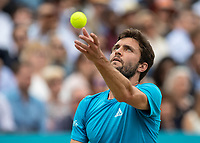 Tennis - 2019 Queen's Club Fever-Tree Championships - Day Seven, Sunday<br /> <br /> Men's Singles Final: Feliciano Lopez (ESP) Vs. Gilles Simon (FRA)<br /> <br /> Gilles Simon (FRA) serves to stay in the match but appears to be looking skyward for inspiration on Centre Court.<br />  <br /> COLORSPORT/DANIEL BEARHAM