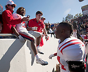 Oct 27, 2012; Little Rock, AR, USA; Ole Miss Rebels running back Jef Scott (3) poses for a photo with fans as linebacker Keith Lewis (24) looks on following a game against the Arkansas Razorbacks at War Memorial Stadium. Ole Miss defeated Arkansas 30-27. Mandatory Credit: Beth Hall-US PRESSWIRE