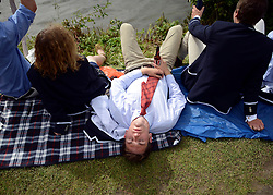 © Licensed to London News Pictures. 27/06/2012. Henley-on-Thames, UK. A man sleeps. Spectators watch rowing crews compete at the Henley Royal Regatta in the early evening sunshine on June 26, 2012 in Henley-on-Thames, England. The 172-year-old rowing regatta is held 27th June- 1st July 2012. Photo credit : Stephen Simpson/LNP