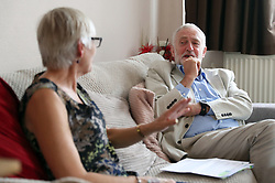 Labour leader Jeremy Corbyn speaks to Carol Woolford about fuel poverty, at her home in Reading West.