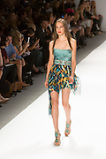 Minidress with a turquoise, black and gold printed skirt, an aqua strapless top, and a turquoise and beaded belt. By Carlos Miele at the Spring 2013 Mercedes-Benz Fashion Week in New York.