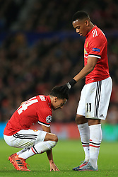 31st October 2017 - UEFA Champions League - Group A - Manchester United v SL Benfica - Anthony Martial of Man Utd rests his hand on injured teammate Jesse Lingard's head - Photo: Simon Stacpoole / Offside.