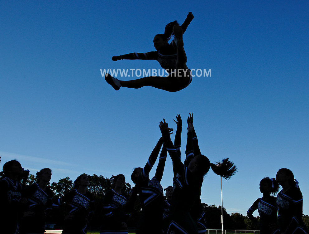 Cornwall cheerleaders warm up before a football game against Pine Bush in Cornwall on Friday, Sept. 6, 2013.