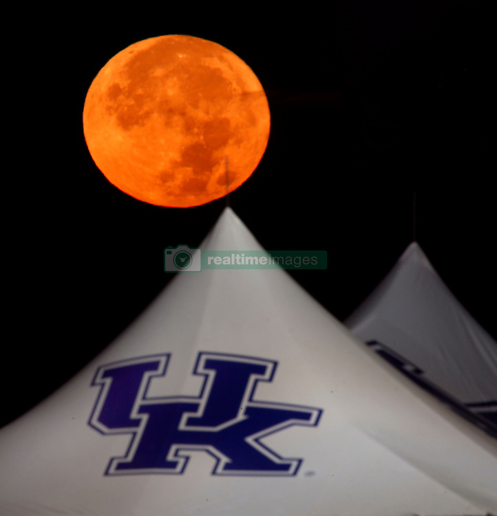November 14, 2016 - Lexington, KY, USA - The ''supermoon'' set behind a tailgating tent in the parking lot of Commonwealth Stadium  on the University of Kentucky parking lot in Lexington Ky., Monday, November 14, 2016. Monday√ïs supermoon was the biggest, brightest and closest it√ïs been to Earth since 1948. √íWhen the moon is full as it makes its closest pass to Earth, it is known as a supermoon,√ì according to NASA. √íThe full moon appears that much larger in diameter and because it is larger shines 30 percent more moonlight onto the Earth. (Credit Image: © Lexington Herald-Leader via ZUMA Wire)
