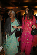 The Rajmata of Jaipur and Edite. Treasures From The Gem Palace, Private view of gem stones created by a family of Indian court jewellers from Jaipur (the Kasliwals). Somerset House, London, WC2, 28 September 2006. www.somerset-house.org.uk-DO NOT ARCHIVE-© Copyright Photograph by Dafydd Jones 66 Stockwell Park Rd. London SW9 0DA Tel 020 7733 0108 www.dafjones.com