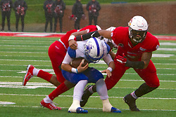 NORMAL, IL - October 26: Christian Uphoff and Romeo McKnight share a tackle on Peterson Kerlegrand during a college football game between the ISU (Illinois State University) Redbirds and the Indiana State Sycamores on October 26 2019 at Hancock Stadium in Normal, IL. (Photo by Alan Look)