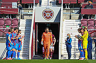 The Inverness players form a guard of honour for the Hearts team before the SPFL Championship match between Heart of Midlothian and Inverness CT at Tynecastle Park, Edinburgh Scotland on 24 April 2021.