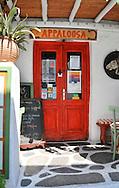 Red door to cafe in greek island of Mykanos in Greece.