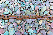 Rusty chain on pebbles at Porlock Weir  in Somerset, United Kingdom