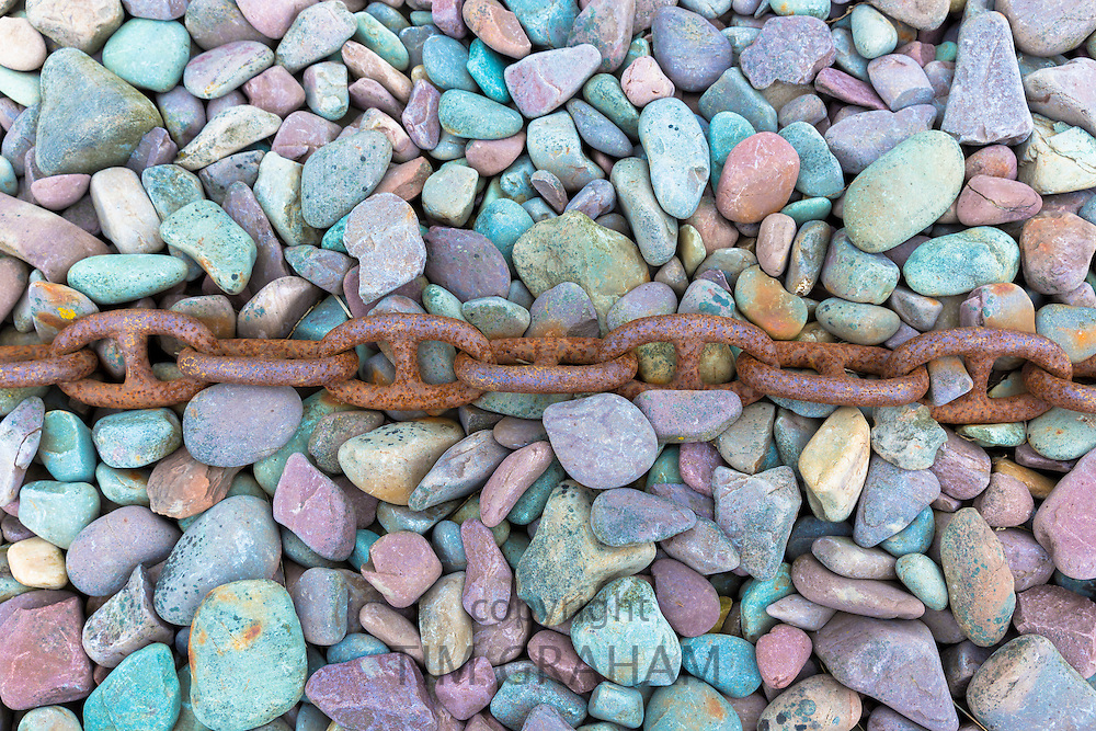 Rusty chain on pebbles at Porlock Weir  in Somerset, United Kingdom