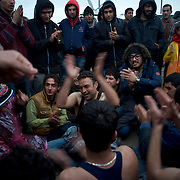 Refugees and migrants chant during a demonstration at the Greek-Macedonian border near the Greek village of Idomeni. Around 13,000 migrants and refugees, mostly from the Middle East and African nations, are believe to be stranded here awaiting a chance to proceed their journey towards Germany and other northern European countries.