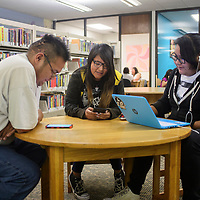 (Left to right) Erwin Tso brings his nieces Tevielynn Yazzie, 14, and Shauntaye Yazzie, 16, to the children's branch of the Octavia Fellin Public Library, Wednesday, July 11 to use the internet.
