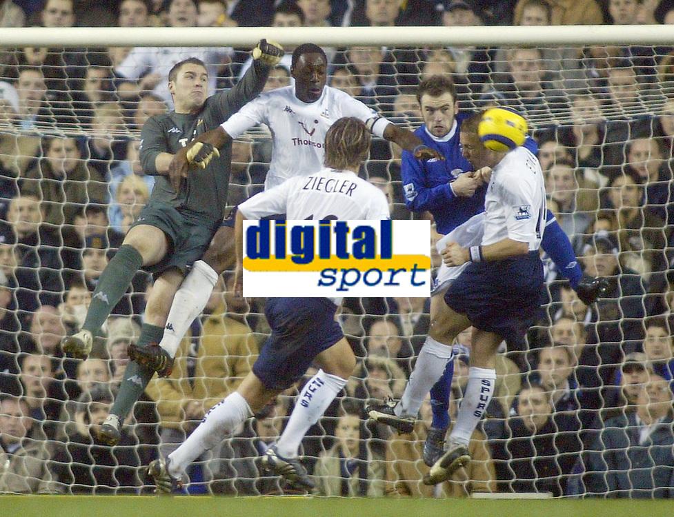 1/1/2005 - FA Barclays Premiership - Tottenham Hotspur v Everton - White Hart Lane<br />Tottenham Hotspur's defence of (L to R) goalkeeper Paul Robinson , Ledley King, Reto Ziegler and Erik Edman combine to thwart Everton's James McFadden<br />Photo:Jed Leicester/Back Page Images