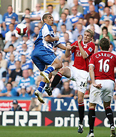 Photo: Chris Ratcliffe.<br />Reading v Manchester United. The Barclays Premiership. 23/09/2006.<br />James Harper of Reading clashes with Darren Fletcher (R) of Man Utd.