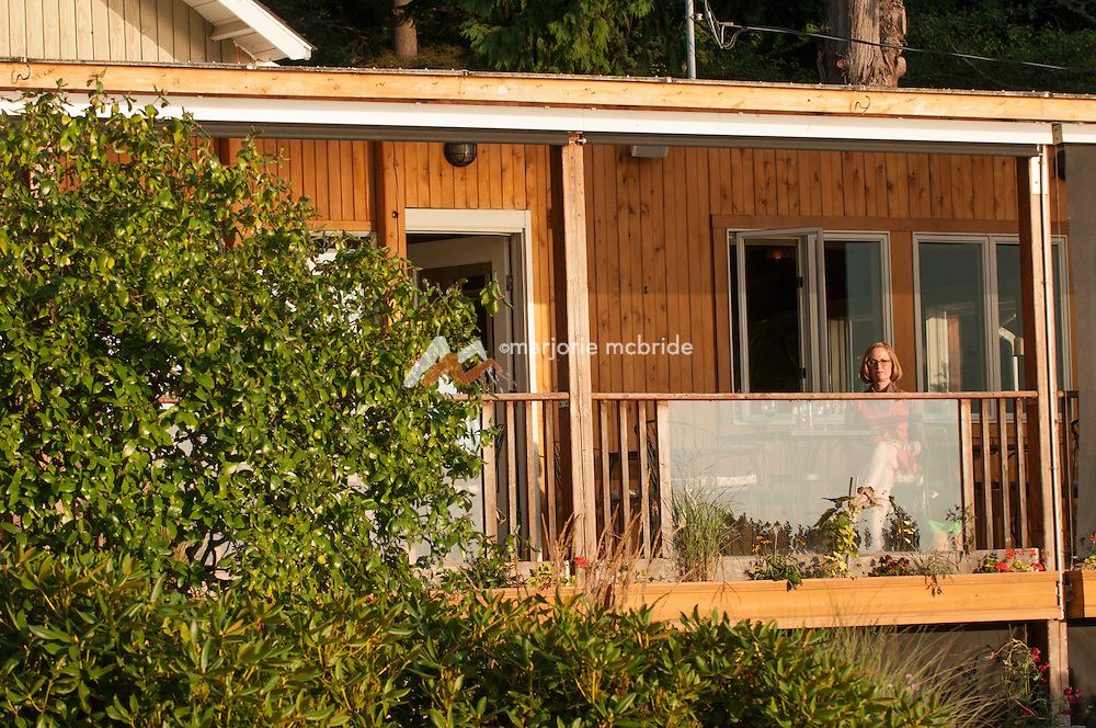 People enjoy dinning outside at the Willows Inn and restaurant on Lummi Island, San Juan Islands, Washington.