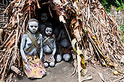 Mbuti Pygmy girls painted in clay for the boys' circumcision ceremony that lasts 5 months pose for a picture in their village in the Ituri Forest on the Okapi Reserve (a UNESCO World Heritage Site) at Epulu, DRC, May 27, 2009. ©Daniel Beltra