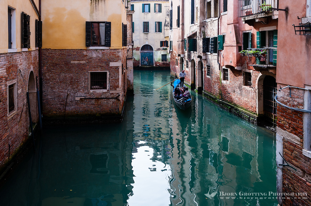Italy, Venice. Gondola on one of the many narrow canals.