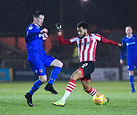 Lincoln City's Matt Green vies for possession with Morecambe's Luke Conlan<br /> <br /> Photographer Andrew Vaughan/CameraSport<br /> <br /> The EFL Sky Bet League Two - Saturday 15th December 2018 - Lincoln City v Morecambe - Sincil Bank - Lincoln<br /> <br /> World Copyright © 2018 CameraSport. All rights reserved. 43 Linden Ave. Countesthorpe. Leicester. England. LE8 5PG - Tel: +44 (0) 116 277 4147 - admin@camerasport.com - www.camerasport.com