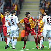 Galatasaray's Gokhan ZAN (C) celebrate his goal during their Turkish Super League soccer match Galatasaray between Eskisehirspor at the TT Arena at Seyrantepe in Istanbul Turkey on Monday, 26 September 2011. Photo by TURKPIX