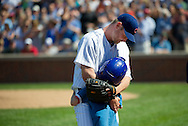 Chicago Cubs relief pitcher Kerry Wood, left, hugs his son Justin after being taken out during the eight inning of a baseball game against the Chicago White Sox, Friday, May 18, 2012 in Chicago. The White Sox won 3-2. Wood faced one batter, striking out Chicago White Sox's Dayan Viciedo, in his final appearance before retiring from baseball.  (AP)