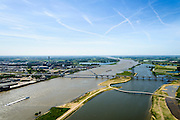 Nederland, Gelderland, Nijmegen, 09-06-2016; de nieuw aangelegde nevengeul van de rivier de Waal, ontstaan door de dijkverlegging bij Lent, gezien naar de niuewe stadsbrug De Ovrersteek. De kleinere brug is De Zaligebrug (Citadelbrug) voor fietsers en voetgangers. <br /> The finished dike relocation of Lent (project Ruimte voor de Rivier: Room for the River) with the resulting flood trench.<br /> luchtfoto (toeslag op standard tarieven);<br /> aerial photo (additional fee required);<br /> copyright foto/photo Siebe Swart