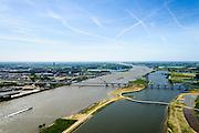 Nederland, Gelderland, Nijmegen, 09-06-2016; de nieuw aangelegde nevengeul van de rivier de Waal, ontstaan door de dijkverlegging bij Lent, gezien naar de niuewe stadsbrug De Ovrersteek. De kleinere brug is De Zaligebrug (Citadelbrug) voor fietsers en voetgangers. <br /> The finished dike relocation of Lent (project Ruimte voor de Rivier: Room for the River) with the resulting flood trench.<br /> luchtfoto (toeslag op standard tarieven);<br /> aerial photo (additional fee required);<br /> copyright foto/photo Siebe Swart