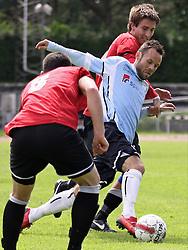 FODBOLD: Morten Juul Hansen (Helsingør) i kamp med Mark Jørming (AB Tårnby) under kampen i Danmarksserien, pulje 1, mellem AB Tårnby og Elite 3000 Helsingør den 12. juni 2010 på Tårnby Stadion. Foto: Claus Birch