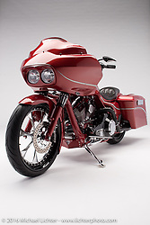 """""""Epic"""", a rubino red bagger built from a 2005 Harley-Davidson Road Glide by Robert """"Pipes"""" Gilliland of Jackson, OH. Photographed by Michael Lichter during the Easyriders Bike Show in Columbus, OH on February 20, 2016. ©2016 Michael Lichter."""