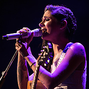 Opening act Christina Perri performs on stage prior to Ed Sheeran at the Amway Center on Tuesday, September 8, 2015 in Orlando, Florida.  (Alex Menendez via AP)