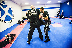 Graduate students pad work as Stef Noij, KMG Instructor from the Institute Krav Maga Netherlands, takes the IKMS G Level Programme seminar today at the Scottish Martial Arts Centre, Alloa.
