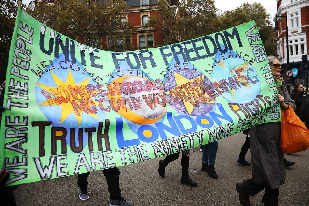 Protest against the continued COvid19 special meassures 24th Octover 2020, London,United Kingdom. The demonstration and protest calls for an end to the ongoing COVID19 meassures across the UK. Many are antivaxxer and believe that the pandemic is exagerated or fake news and noone were socially distancing or wearing masks.