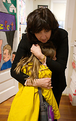 17 Jan, 2006. New Orleans, Louisiana. Post Katrina. School re-opening. Principal Kathy Riedlinger greets children returning to Lusher Charter School in uptown New Orleans on their first day back since Hurricane Katrina. Kathy lost her home and all her possessions to the storm and is currently living with friends. The school suffered $2 million in damages and has been repaired and returned to service with the help of contractors and parents who have worked tirelessly to re-open the facility to students.<br /> Photo; Charlie Varley/varleypix.com